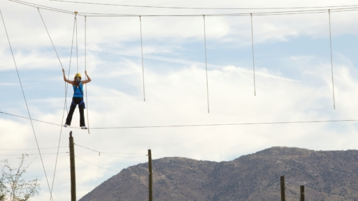woman walking across tightrope in arizona
