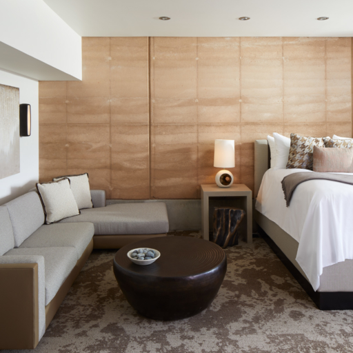 couch and bedding in miraval arizona resort & spa suite
