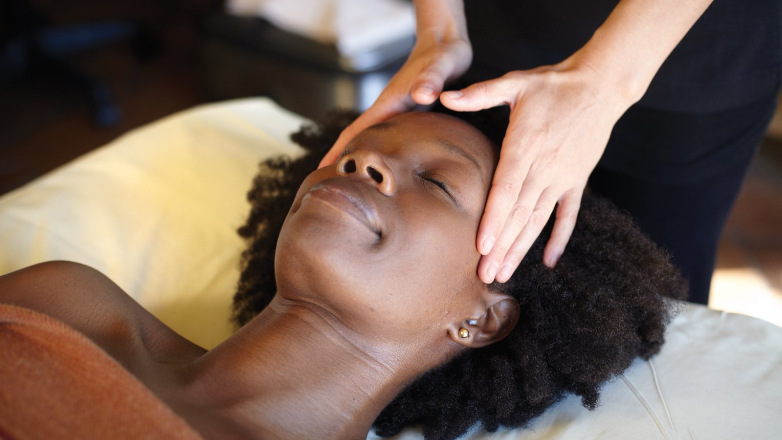 woman receiving exquisite gemstone facial at miraval life in balance spa
