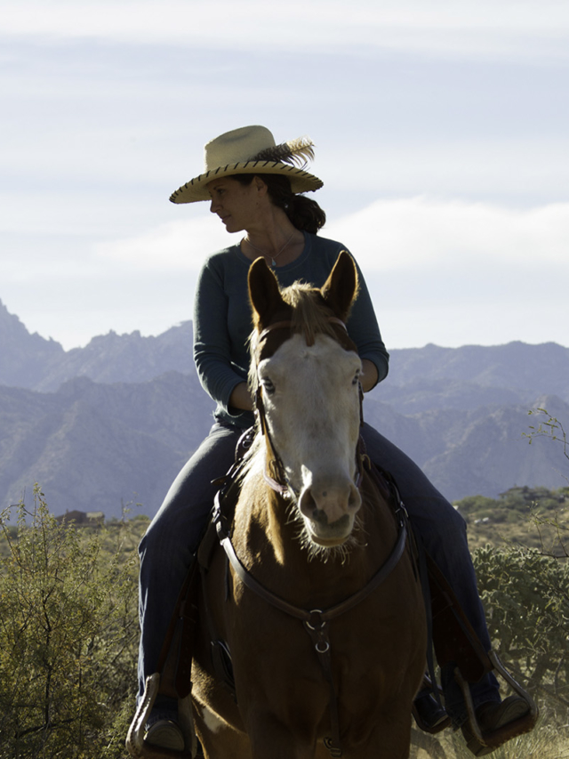 Woman enjoys horseback riding at Miraval Arizona.