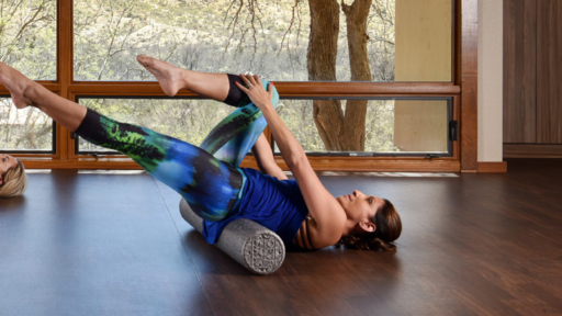 woman stretching at miraval's fitness center