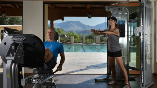 man and woman working out at a miraval arizona resort & spa's fitness center