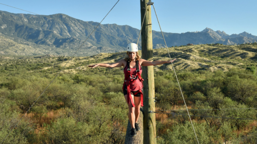 woman enjoying the out on a limb challenge at miraval arizona resort & spa