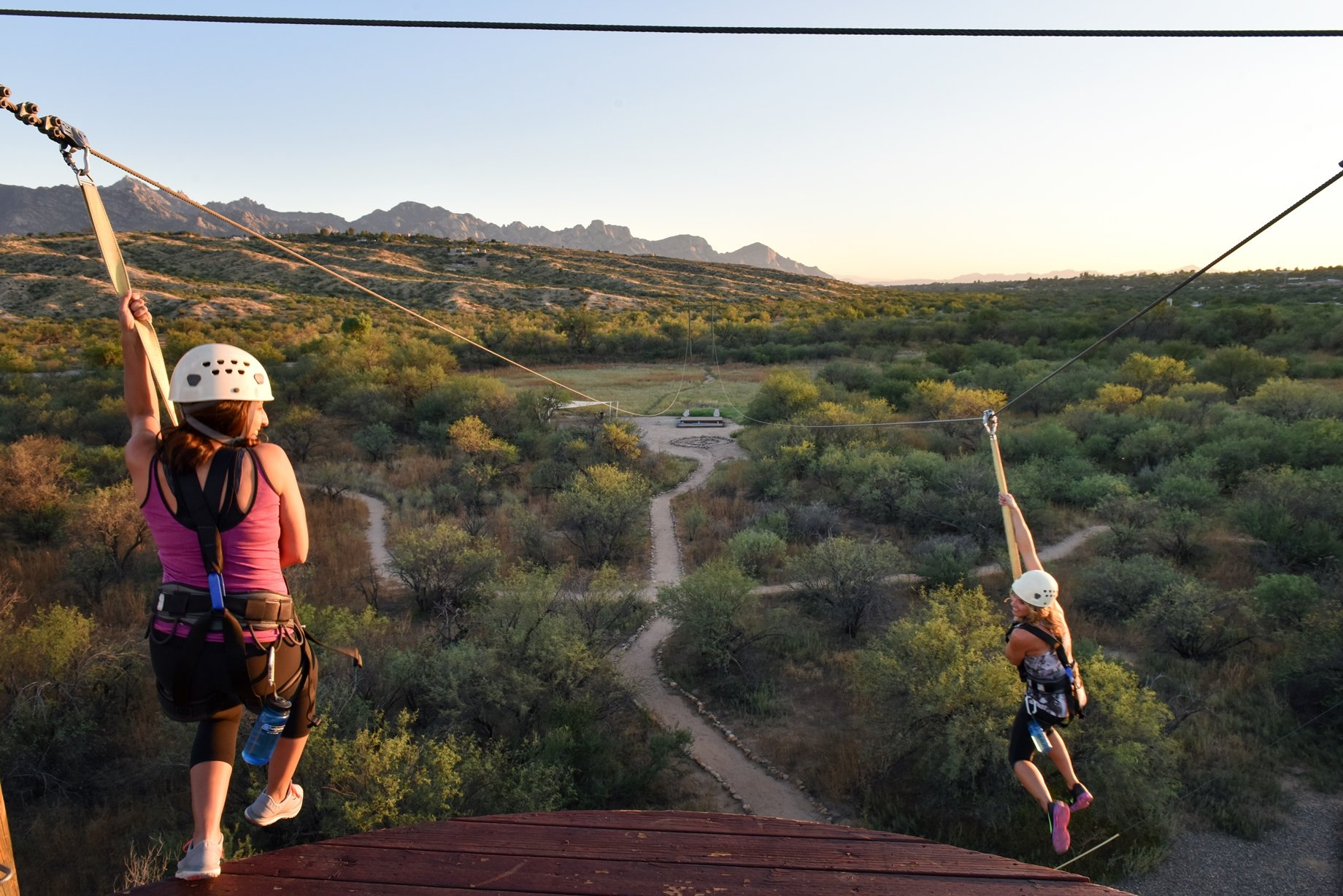 woman ziplining over the tucson desert