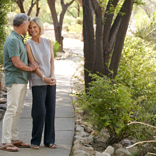 couple enjoying a private moment on a tree-lined pathway