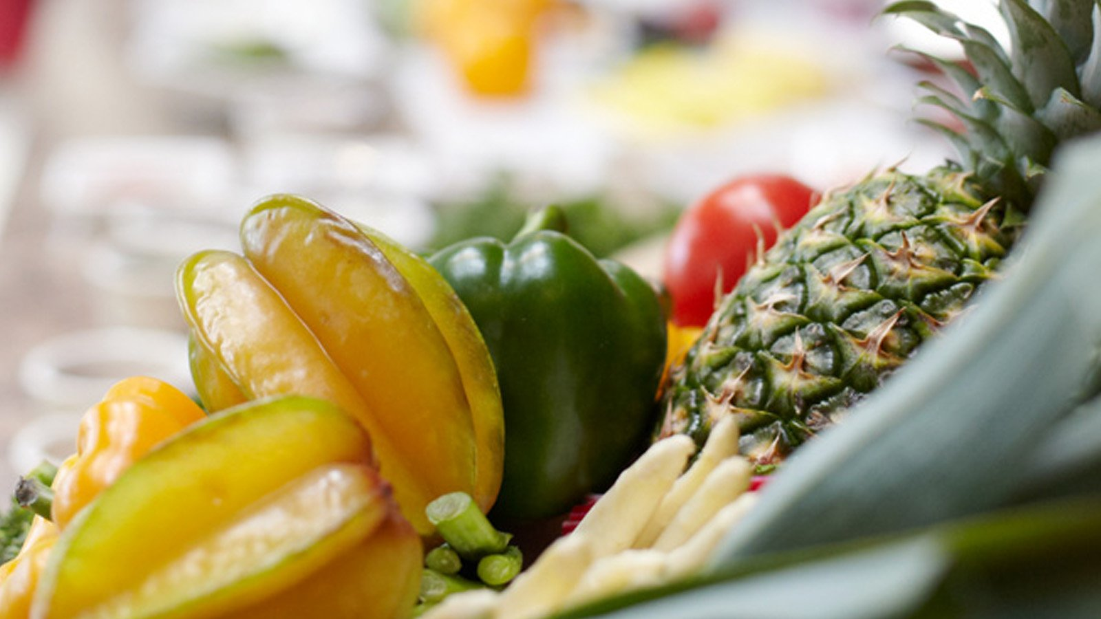 fresh fruit and vegetables in a dish
