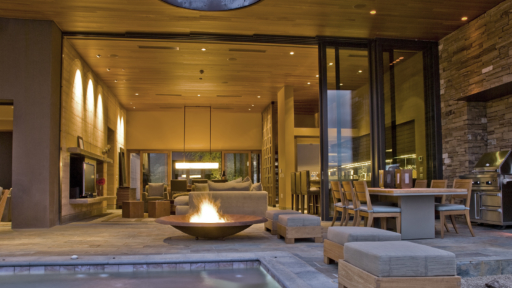 spa and fireplace attached to indoor/outdoor living space