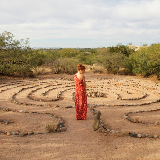 woman overlooking the labyrinth walk at miraval arizona resort & spa