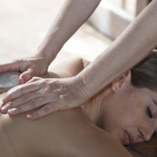 woman indulging in a hot stone spa treatment