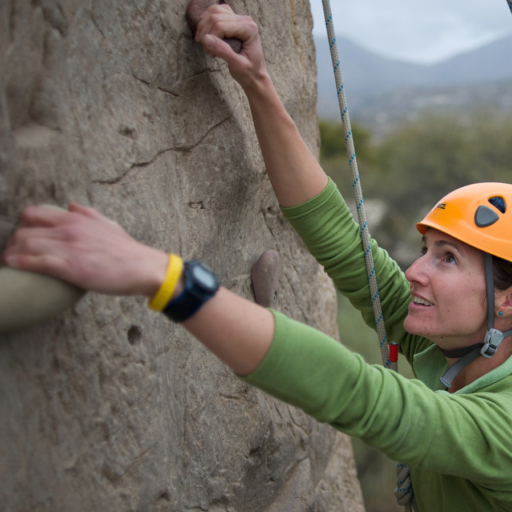 woman rock climbing in tucson