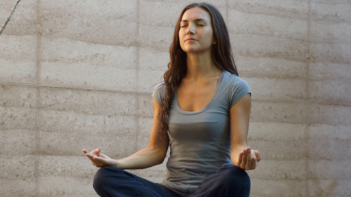 woman meditating in full lotus pose