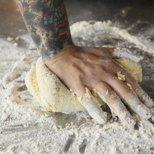 thead pastry chef of miraval arizona resort & spa kneading gluten-free cookie dough