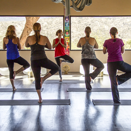 group of women participating in a yoga class at miraval arizona resort & spa