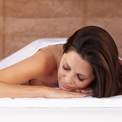 woman laying on massage bed at miraval life in balance spa