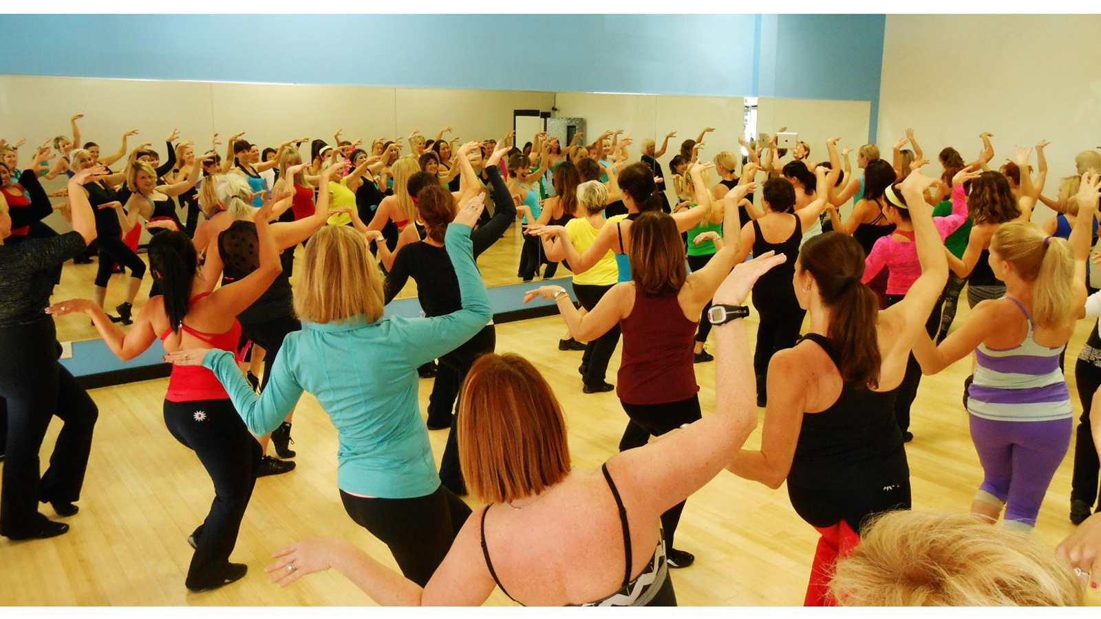 Large group of guests engages in dance class at Miraval Arizona.