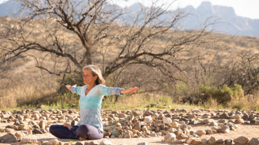 instructor tejpal meditating in the arizona desert