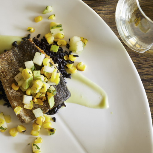 gourmet fish entree on black rice