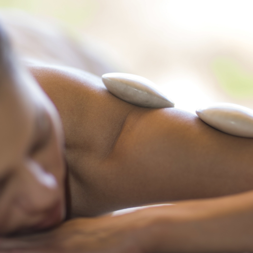 person relaxing with outdoor hot stone treatment
