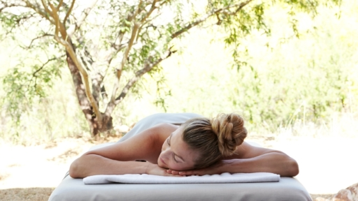 woman laying on her stomach awaiting a massage