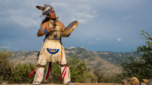 native american man performing a ritual
