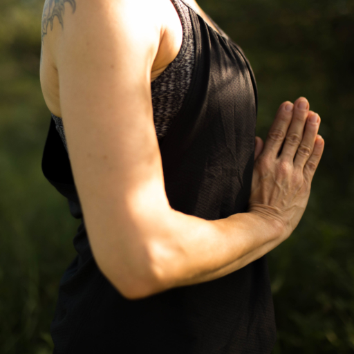 woman with hands folded in front of her