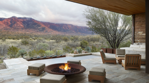 Seating area around a patio firepit with mountain view
