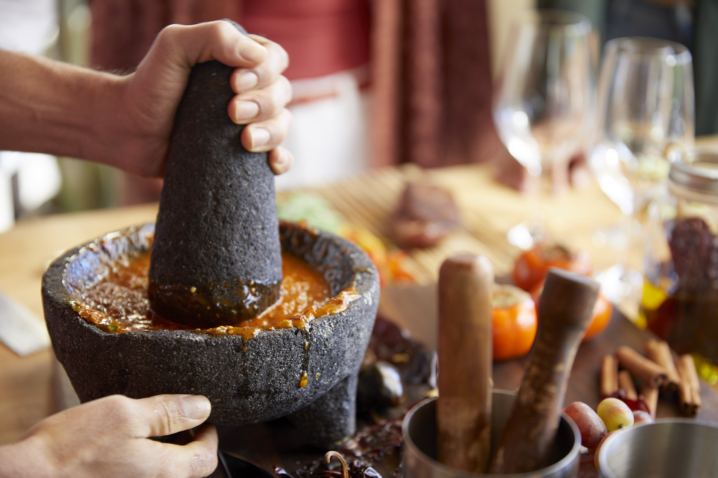 making salsa with a mortal and pestle