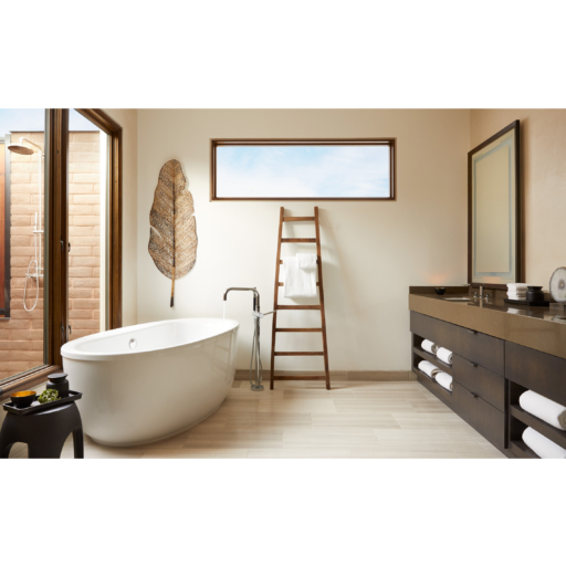 bathroom with a tub and double sink vanity
