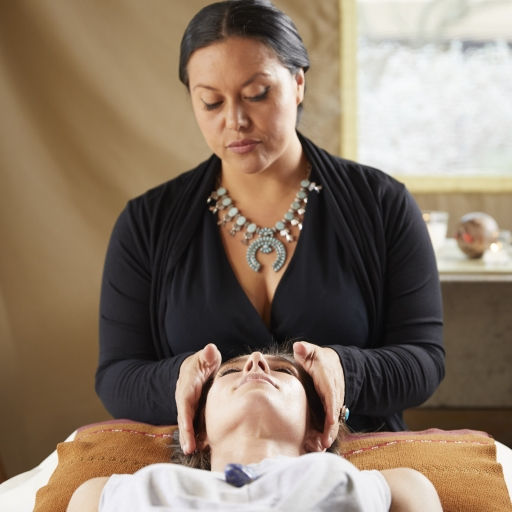 therapist performing energy healing on client