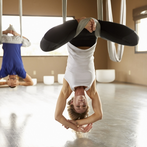 couple experiences deep stretching with aerial yoga