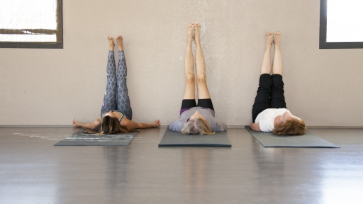 group practicing active relaxation yoga postures