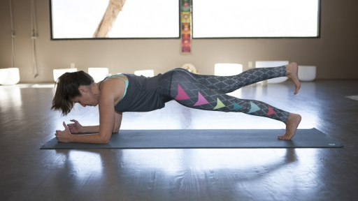 woman strengthens her core with yoga