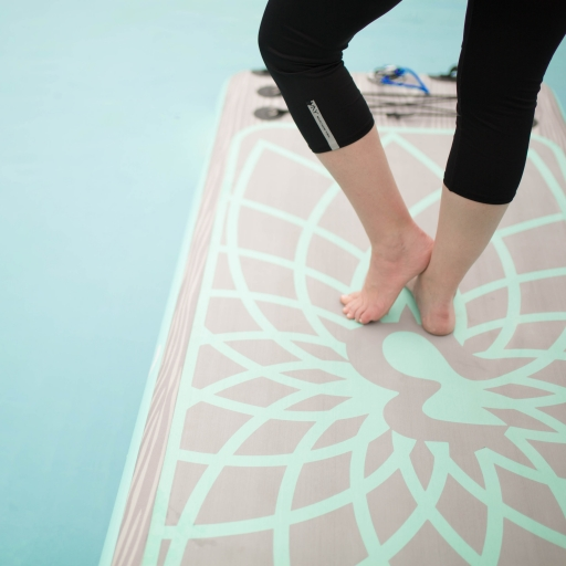 person standing on a yoga mat