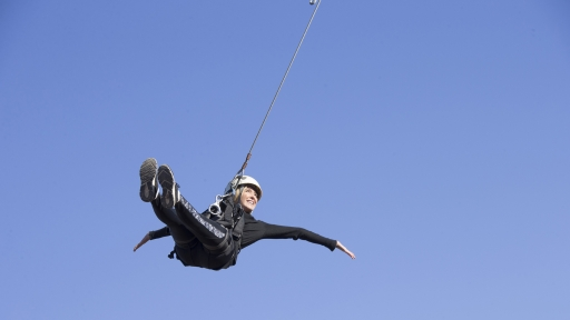 woman swinging high above the ground