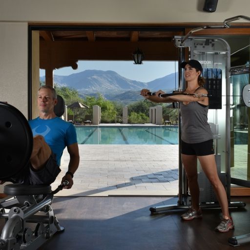 couple using exercise equipment at miraval arizona resort & spa