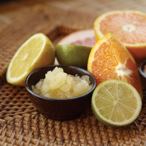 assortment of sugar scrubs and citrus fruits