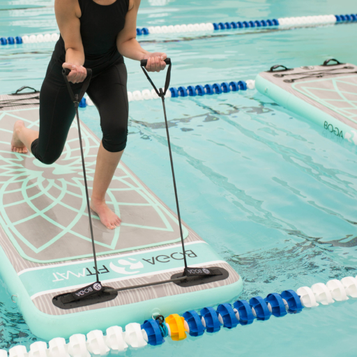 Woman exercises in pool with floating fit mat at Miraval Arizona.