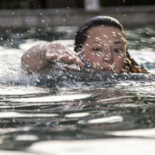 Close up of woman swimming at Miraval Arizona.