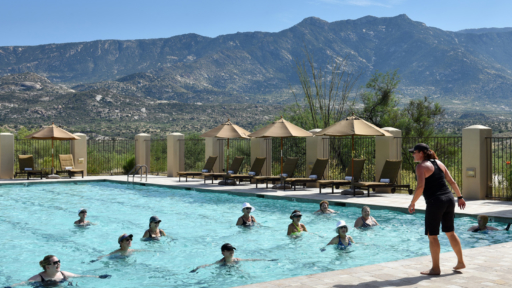 outdoor fitness pool at miraval arizona resort & spa overlooking the mountains