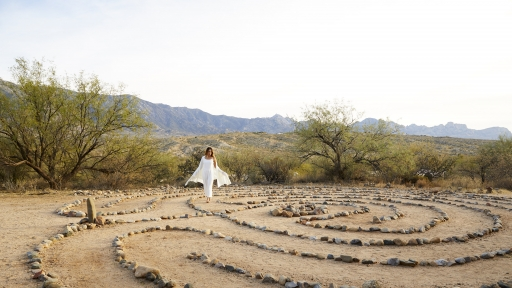 Woman walks around the lotus stone garden at Miraval Arizona.