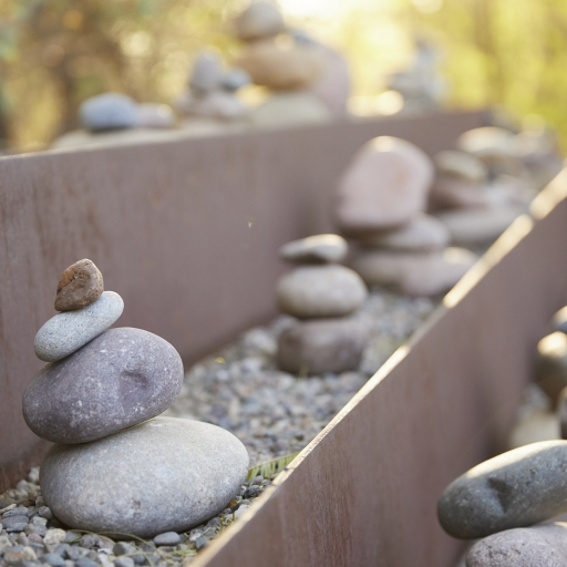 Close up of balanced stones arranged outside Miraval Arizona.