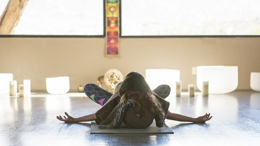 woman practicing yoga with aromatherapy