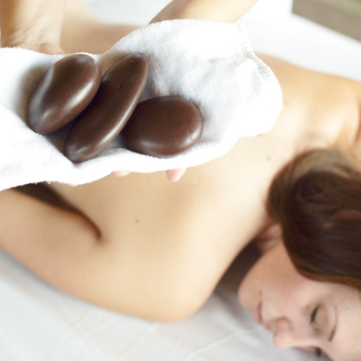 woman receiving calming hot stone massage at miraval life in balance spa in tucson