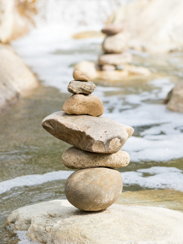 Balanced stones lined up on small creek at Miraval Arizona.