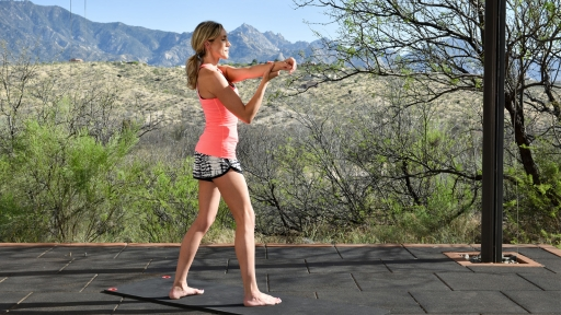 Woman stretches outdoors at Miraval Arizona.