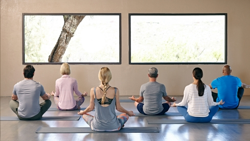 group of people in a yoga nidra meditation class