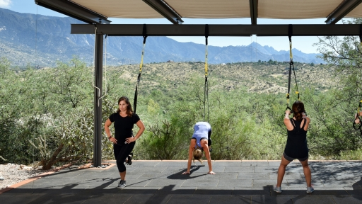 group of women performing the trx endurance circuit at miraval arizona resort & spa