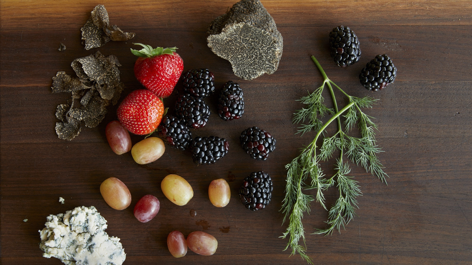 fresh fruit and herbs on a cutting board