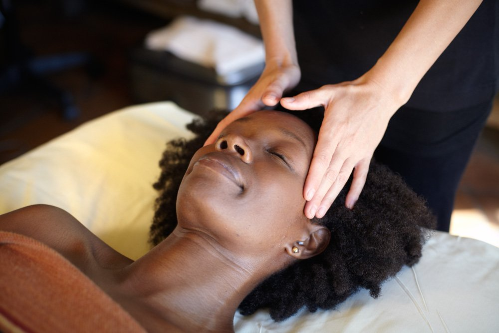 Woman getting her scalp massaged at our spa resort in tucson