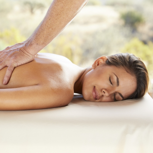 woman getting a massage at life in balance spa